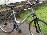 Btwin triban adults hybrid/mountain bike