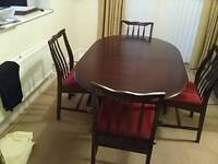 Stag Minstrel Dining Table with 4 chairs.
