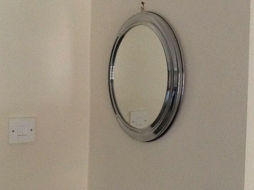 Round Mirror In Chrome Silver Frame Looks Beautiful