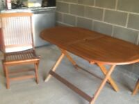 Quality wooden garden table and 4 folding chairs