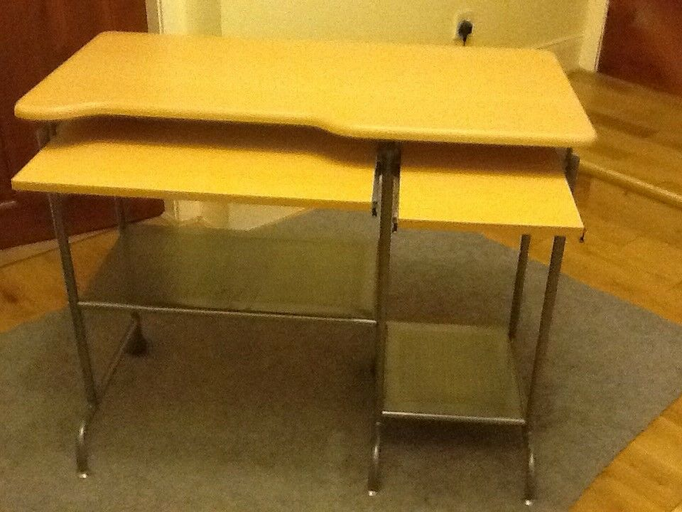 Gold laminate with aluminium shelves and wheeled legs ideal for uni student