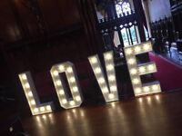 Giant light up LOVE letter hire, Starlight Backdrop, Chair covers and more.