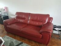 2 & 3 seater red leather sofa excellent condition. stainless steel legs . was £3000 new feom harveys