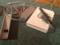 Wii console and 2 controllers