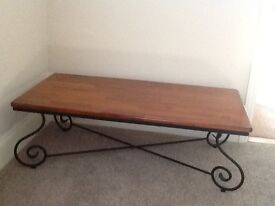 Smart mahogany coffee table with black wrought iron legs, very good condition.