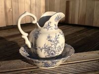 This Beautiful ornate decorative Water Jug & basin with blue design on a antique white glaze.