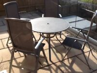 REDUCED - Patio set, round table, 4 adjustable chairs and parasol