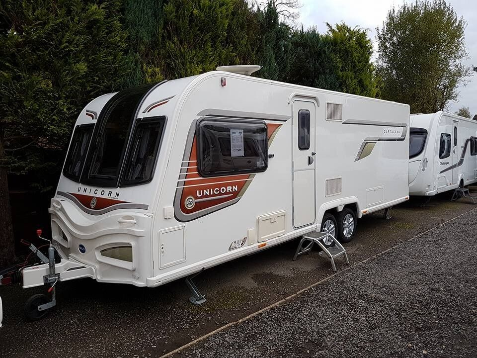 Bailey Unicorn Cartagena 4 berth caravan 2014 FIXED ISLAND BED, MOTOR MOVER, VGC