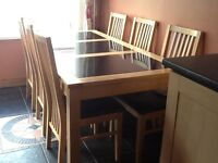 Light oak dining table approx 6X3ft with 6 chairs very good condibtion. Stylish and modern.