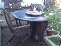 Fold away real hard wood table and 4 chairs