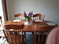 Oval extendable oak dining room table and chairs