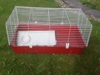 Large cage, suitable for a rabbit or Guinea pig. Used but in great condition.