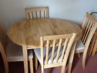 Extending dining table and four dining chairs