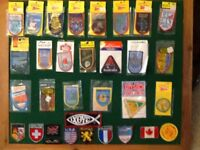 Large quantity of sew on iron badges.a .mostly of Australia all in new order.