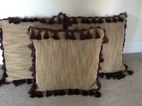 3 lounge cushions with tassels