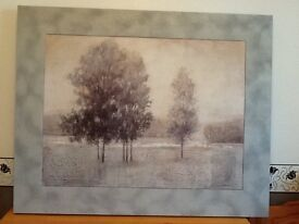 A large canvas picture, grey in colour. A wintery scene, very calming.