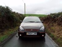 ford focus flight. aftermarket alloys tints and lowered in black with orange trims