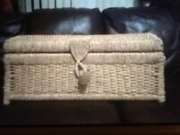 Wicker storage chest.