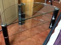 Tv stand glass and chrome large half moon shape 1100cms along front 56cms deep suitable for large tv