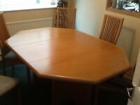 Dinning Room Table with 6 High back chairs.