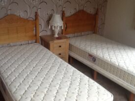 As new two single beds and mattress with pine headboards buyer collects