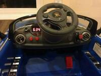 Electric sit and ride car with remote control, mp3 and flashing head lights