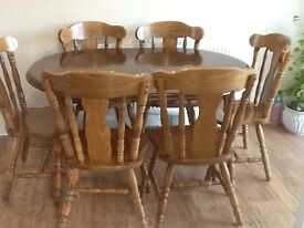 wood extending table and 6 chairs extends to 3 sizes 43 ,55,67 inches.