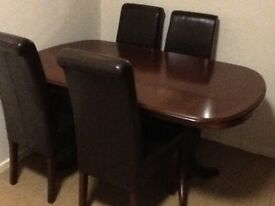 Solid wood extending dining table & 4 scroll back chairs