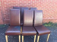 X6 leather look chairs