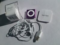 iPod Shuffle 4th generation, pink, as new with unused earphones & charging lead.