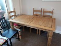Wood dining table with 3 matching chairs along with 3 different chairs. Open to offers