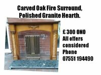 Carved Oak Fire Surround With a Polished Granite Hearth