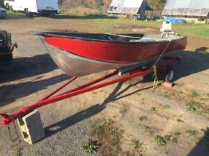 $900 or trade - 12 ft. Alum boat with outboard