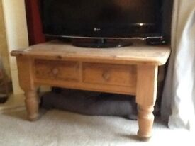 A great coffe table with two draws or tv unit