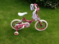 Girls junior bike, pink with stabelisers