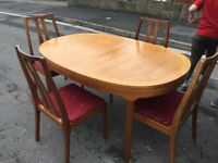 Solid pine extending dining table and chairs