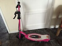 Kids Razor E100s electric scooter with optional seat