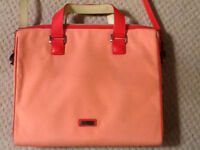 Coral coloured Tumi satchel