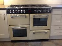Dual fuel range cooker 7 gas burners 3 electric ovens