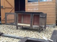 2 rabbit hutches with 2 sections
