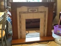 Solid wood and tiled fireplace surround 122 X 106 cm