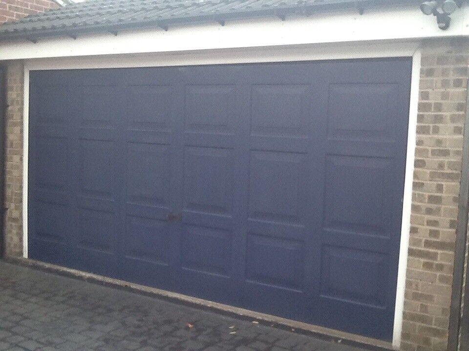 Double electric Georgian garage door good working condition