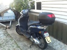 PIAGGIO FLY 125 cc with rack and top case in good condition Hobart CBD Hobart City Preview
