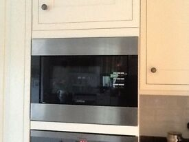 Lamona built in microwave oven. Very clean and well maintained. Four years old.