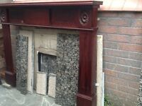 Mahogany fire surround and marble inset and hearth.