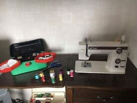 New home sewing machine in table ..VGC