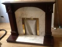 Oak coloured fire surround. Used. Good condition.