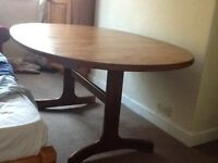 Extendable oval-shaped solid wood dining table, 6-8 seater,complete with 4 solid wood chair