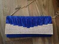 Blue and ivory/pink clutch bags
