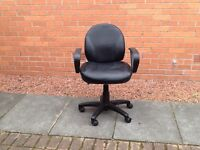 Black leather look office chair on five castors
